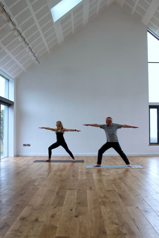 People stretching inside Iona Hall